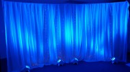 Pipe & Drape Backdrop w/Light Curtain 12' Curved (w/Blue Uplighting)